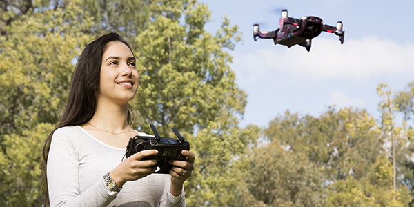 Female student driving a drone